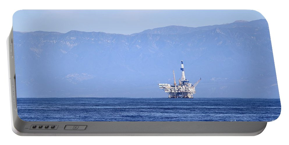 Sea Portable Battery Charger featuring the photograph Oil Rig by Henrik Lehnerer