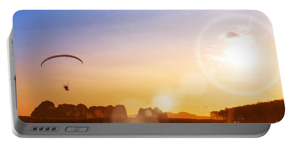 Action Portable Battery Charger featuring the photograph paramotor at Krabi province by Atiketta Sangasaeng