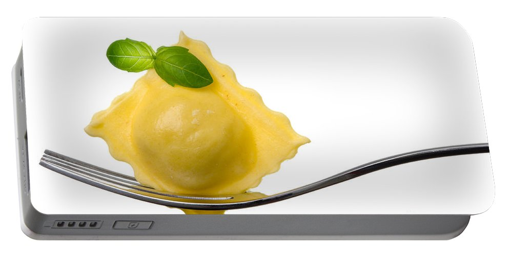 Pasta Portable Battery Charger featuring the photograph Ravioli Pasta Parcel And Basil Garnish On Fork White Background by Lee Avison