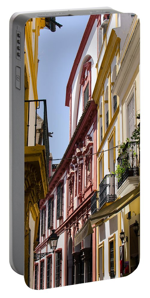 Seville Portable Battery Charger featuring the photograph Streets Of Seville - Magic Colours by Andrea Mazzocchetti