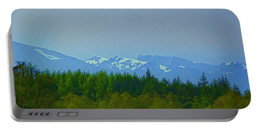 Blue Sky Portable Battery Charger featuring the photograph Treeline With Ice Capped Mountains In The Scottish Highlands by Ashish Agarwal