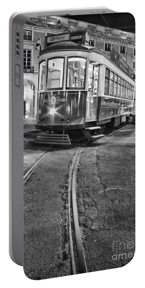 Lisbon Portable Battery Charger featuring the photograph Typical Lisbon Tram In Commerce Square by Jose Elias - Sofia Pereira