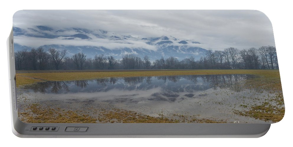 Field Portable Battery Charger featuring the photograph Water Puddle by Mats Silvan