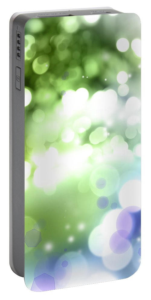 Abstract Portable Battery Charger featuring the photograph Abstract Circles 51 by Les Cunliffe