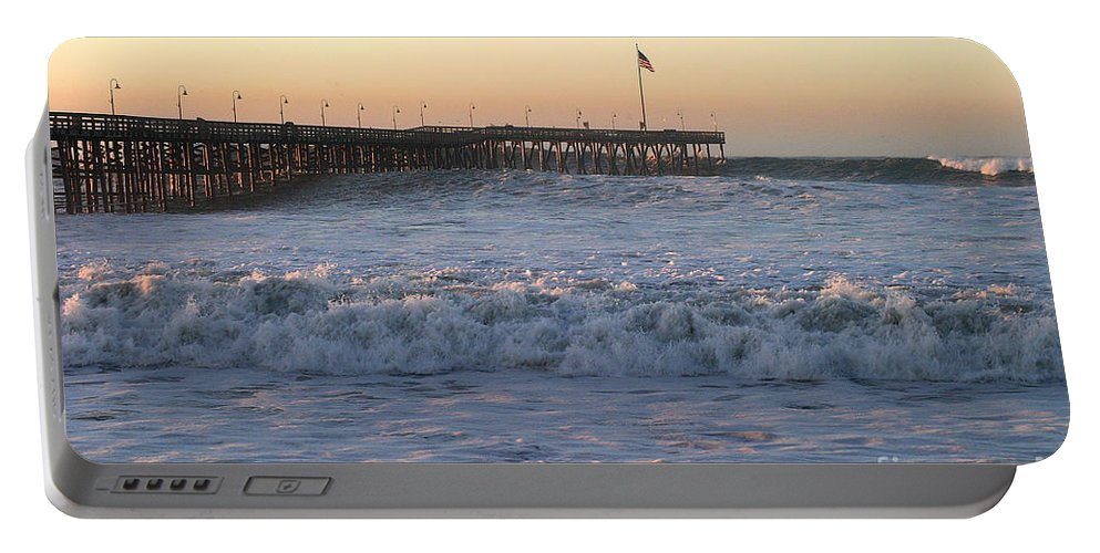 Storm Portable Battery Charger featuring the photograph Ocean Wave Storm Pier by Henrik Lehnerer