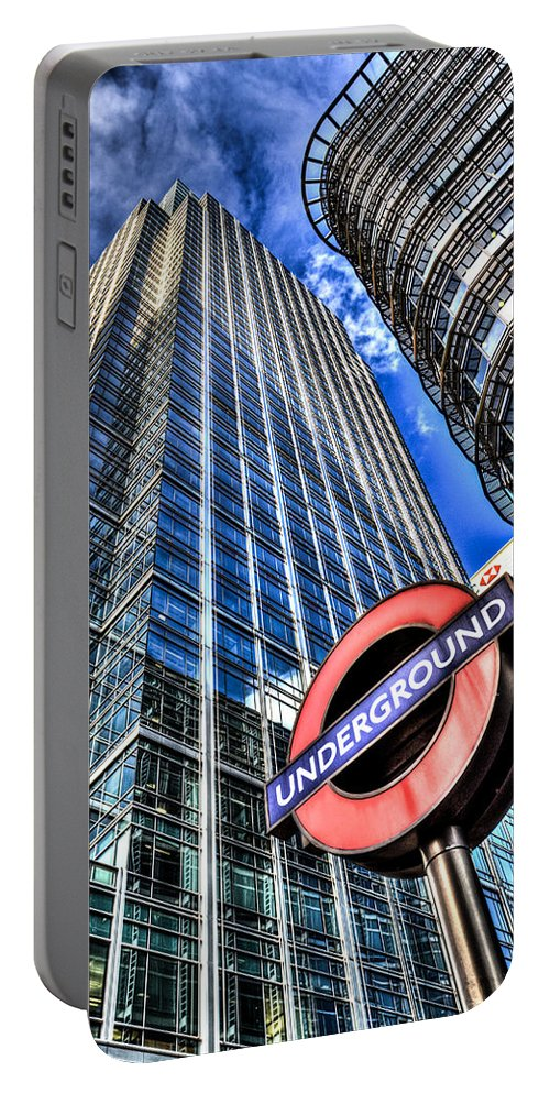 Taxi Taxis Portable Battery Charger featuring the photograph Canary Wharf London by David Pyatt