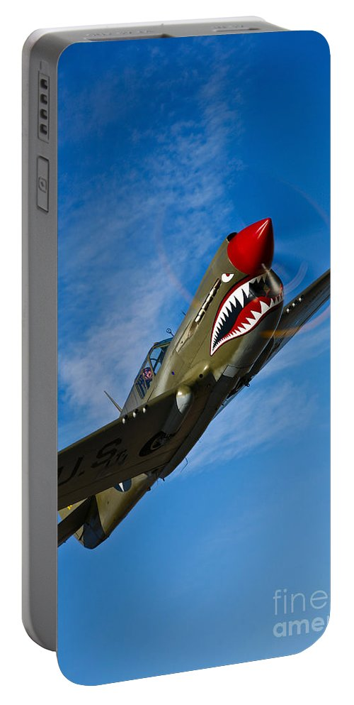 Vertical Portable Battery Charger featuring the photograph A Curtiss P-40e Warhawk In Flight by Scott Germain