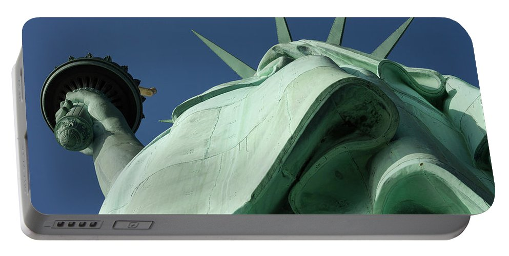 Photography Portable Battery Charger featuring the photograph Low Angle View Of Statue Of Liberty by Panoramic Images