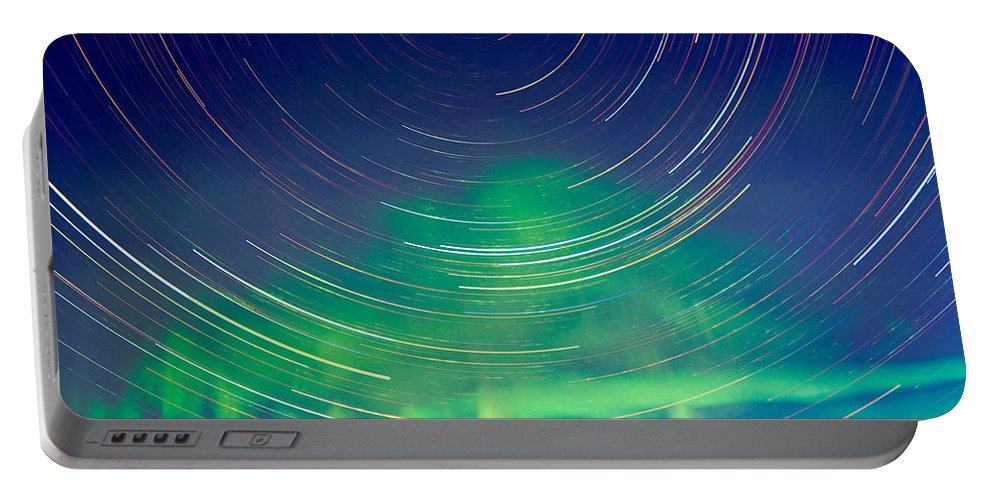 Astrophoto Portable Battery Charger featuring the photograph Star Trails And Northern Lights In Night Sky by Stephan Pietzko