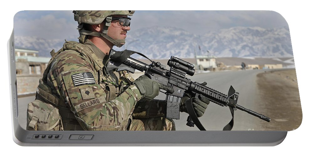 Us Army Portable Battery Charger featuring the photograph U.s. Army Specialist Provides Security by Stocktrek Images