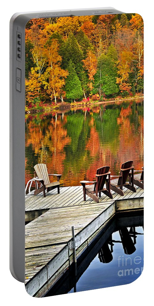 Lake Portable Battery Charger featuring the photograph Wooden Dock On Autumn Lake by Elena Elisseeva
