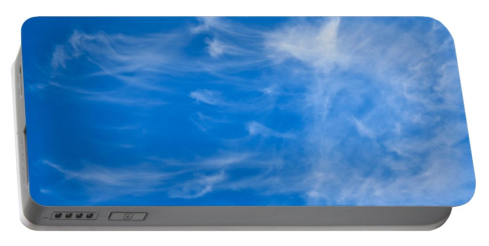 Summer Portable Battery Charger featuring the photograph In The Clouds by David Pyatt