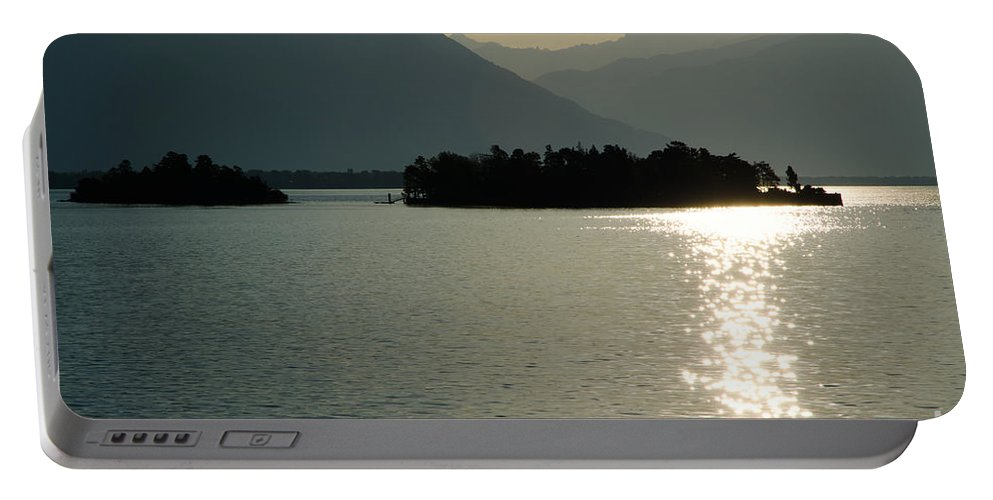 Islands Portable Battery Charger featuring the photograph Sunshine Over An Alpine Lake by Mats Silvan