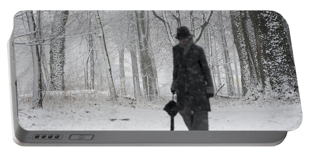 Woman Portable Battery Charger featuring the photograph Snowy Day by Mats Silvan