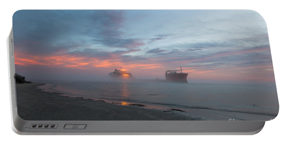 Sunset Portable Battery Charger featuring the photograph Ghost Ship by Dale Powell