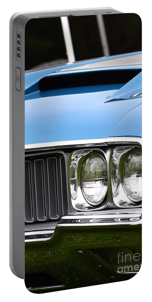 Portable Battery Charger featuring the photograph 60's Oldsmobile 442 by Dean Ferreira