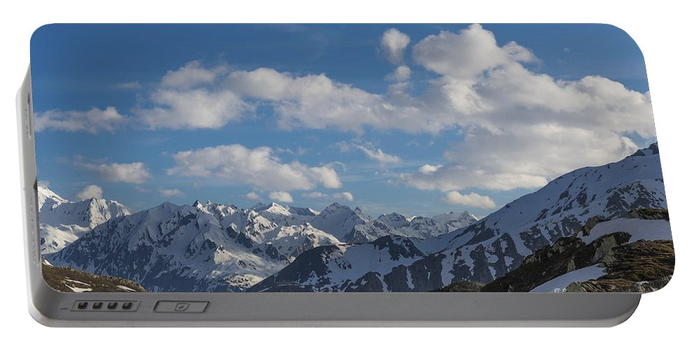 Snow-capped Portable Battery Charger featuring the photograph Swiss Alps by Mats Silvan