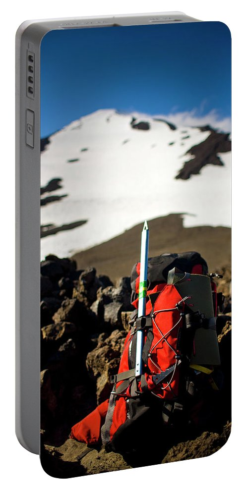 Alpine Portable Battery Charger featuring the photograph A Backpack Sits On Rocks by Kirk Mastin