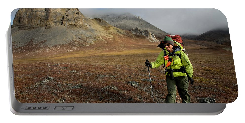 Active Portable Battery Charger featuring the photograph A Backpacker Makes Her Way by Eric Rorer