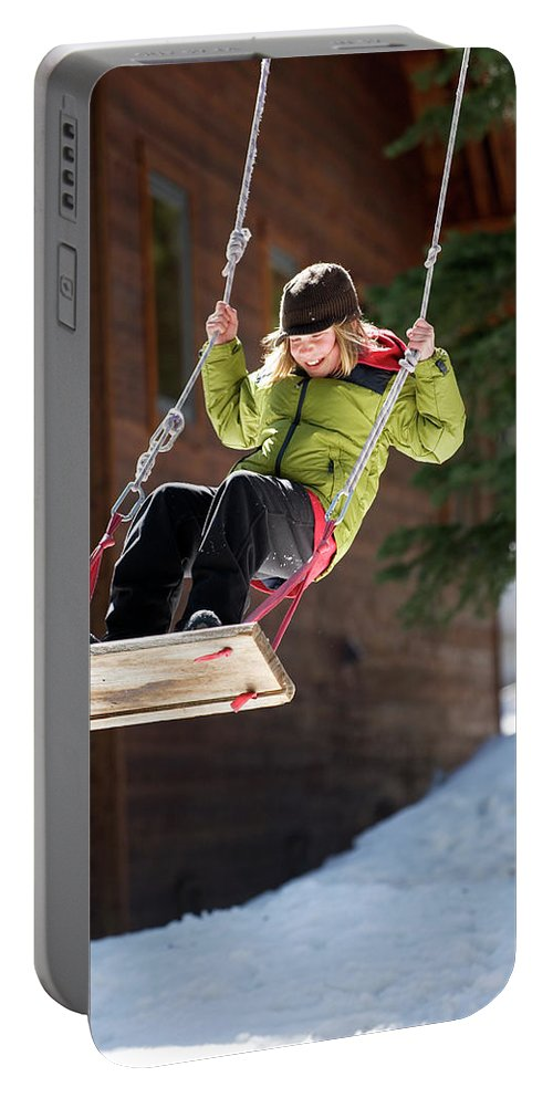 10-11 Years Portable Battery Charger featuring the photograph A Boy Plays Outside In Lake Tahoe by Corey Rich