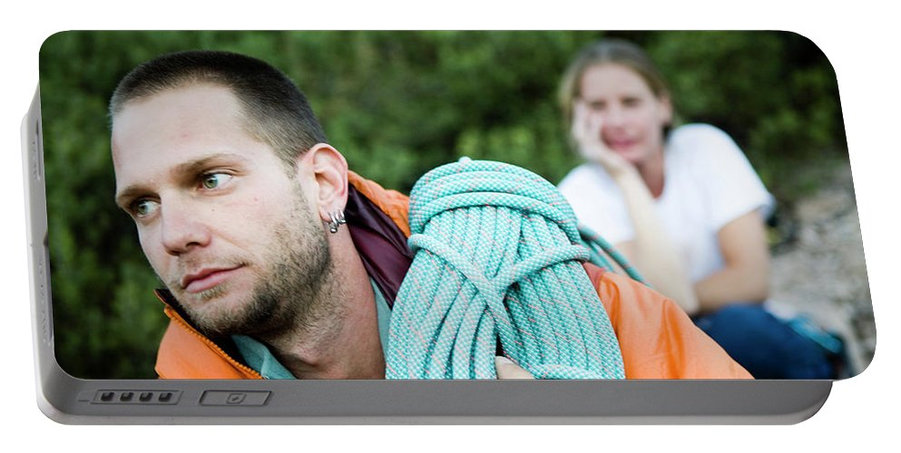 Ahtletes Portable Battery Charger featuring the photograph A Climber Holds Ropes Over Shoulder by Jay Reilly