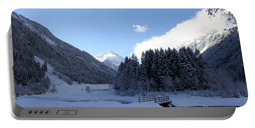 Winter Portable Battery Charger featuring the photograph A Cold Winter Day by Christiane Schulze Art And Photography