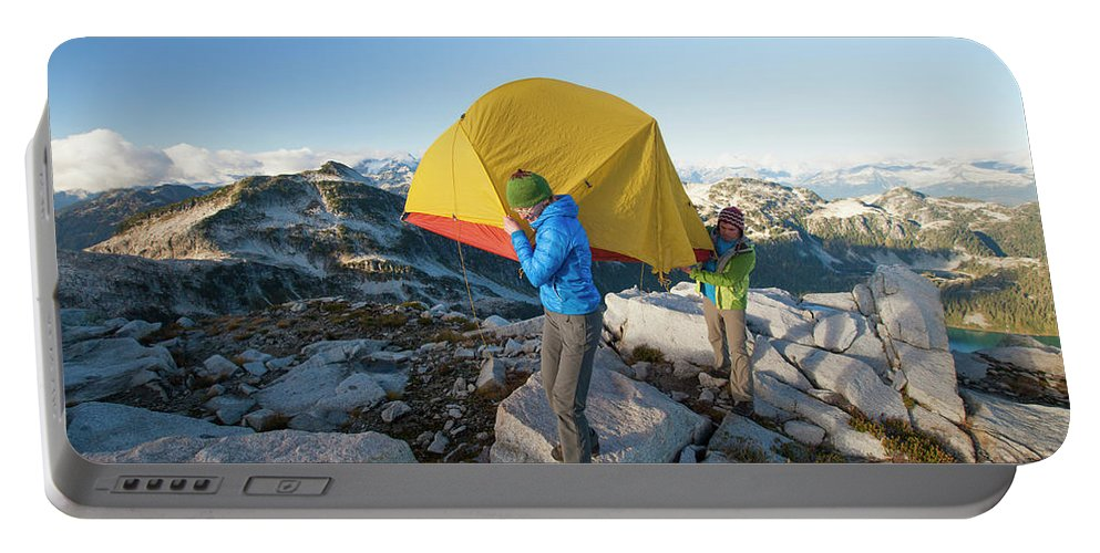 British Columbia Portable Battery Charger featuring the photograph A Couple Of Backpackers Carry by Christopher Kimmel