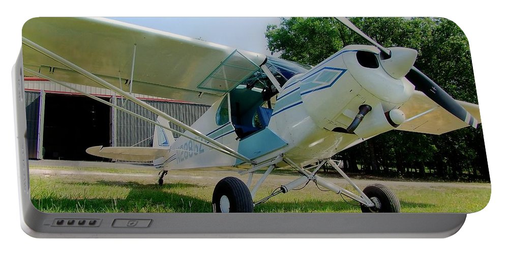 Piper Portable Battery Charger featuring the photograph A Cub In The Grass by Phil Rispin