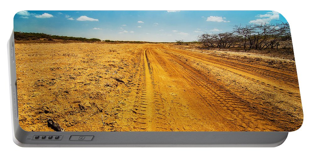 Desert Portable Battery Charger featuring the photograph A Dirt Road In The Desert by Jess Kraft