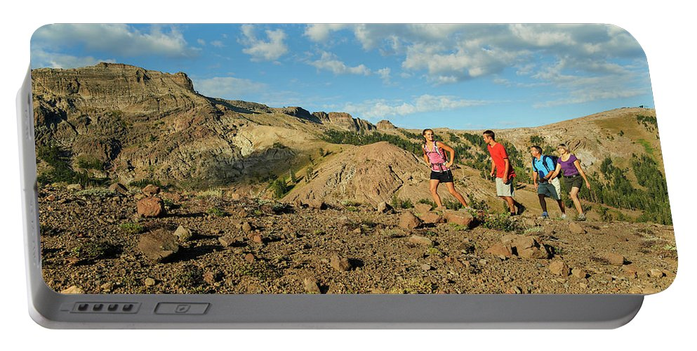 Adventure Portable Battery Charger featuring the photograph A Family Enjoys The Views by Jack Affleck