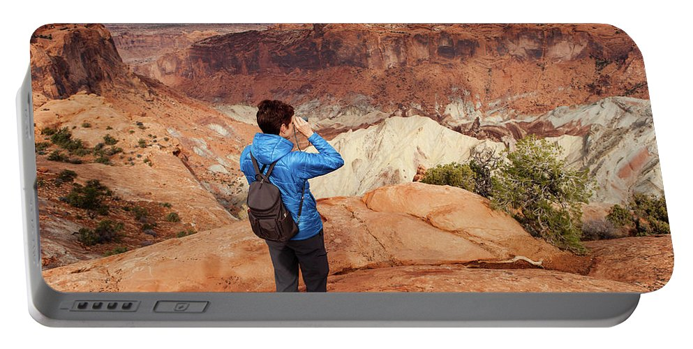 Holding Portable Battery Charger featuring the photograph A Female Hiker Looking by Ron Koeberer