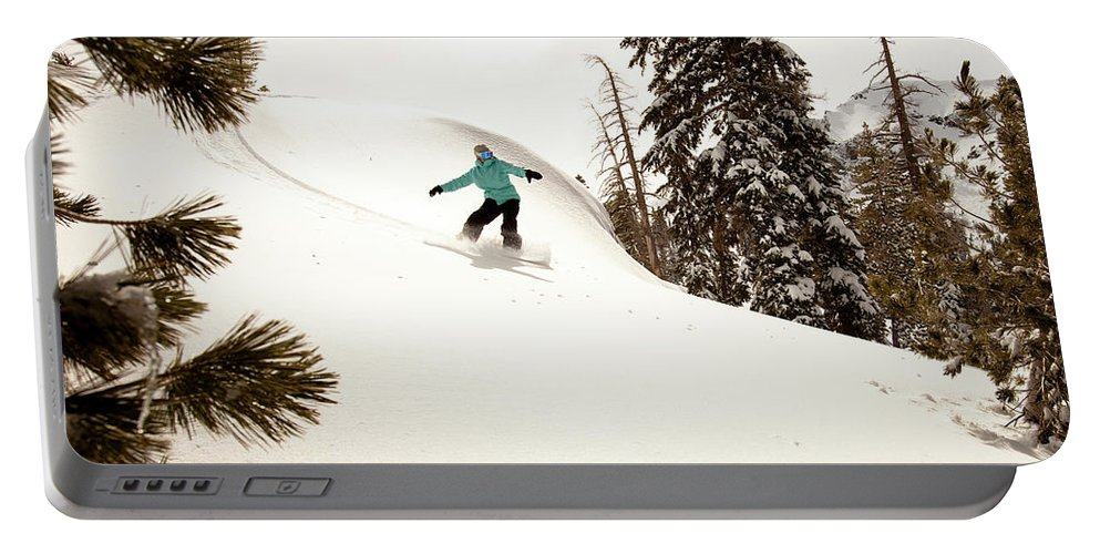 California Portable Battery Charger featuring the photograph A Female Snowboarder Lays Out Some by Kyle Sparks