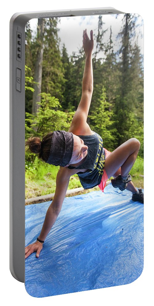 Exercising Portable Battery Charger featuring the photograph A Fit Woman Completes A Morning by Christopher Kimmel