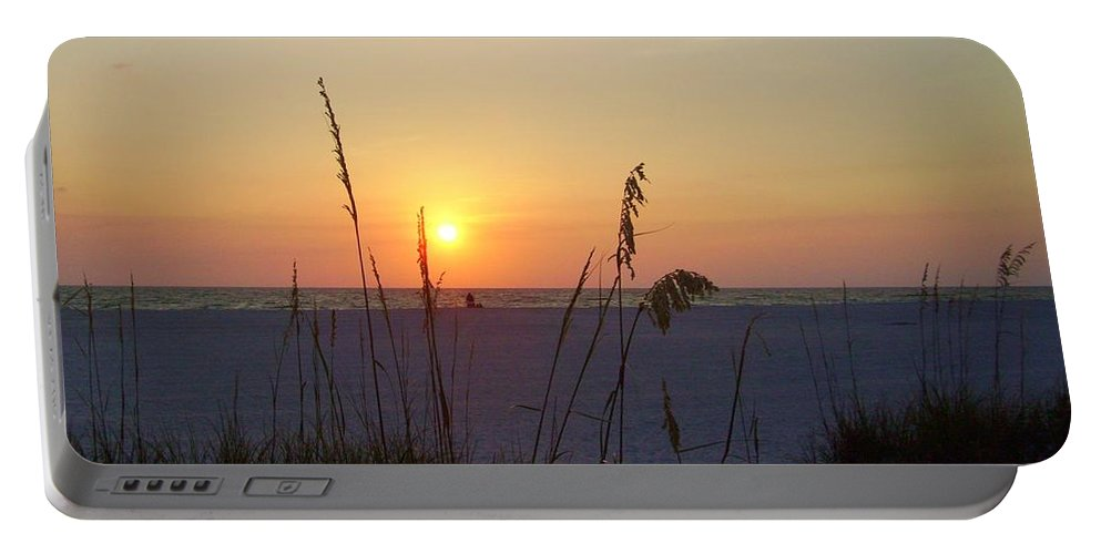 Ocean Portable Battery Charger featuring the photograph A Florida Sunset by Cynthia Guinn