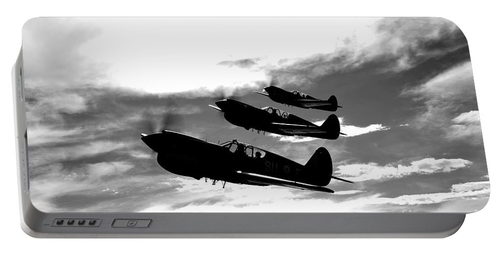 Horizontal Portable Battery Charger featuring the photograph A Group Of P-40 Warhawks Fly by Scott Germain