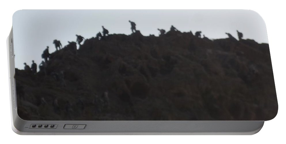 Mountain Portable Battery Charger featuring the photograph A Line Of People Walking On A Mountain by Shea Holliman