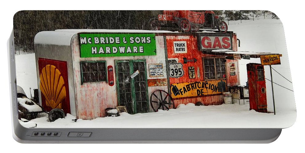 Outdoor Display Portable Battery Charger featuring the photograph A Little Out Of The Way by Glenn McCarthy Art and Photography