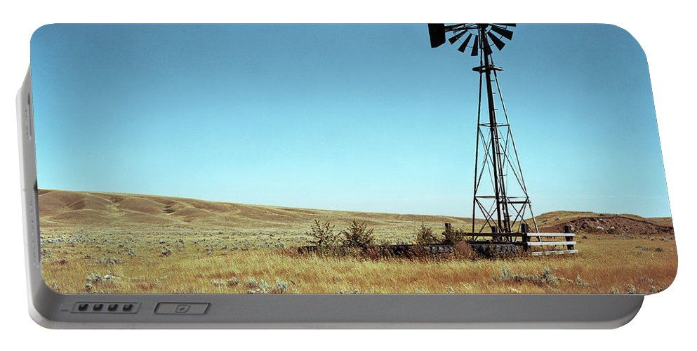 Agriculture Portable Battery Charger featuring the photograph A Lone Windmill Stands On The Canadian by Todd Korol