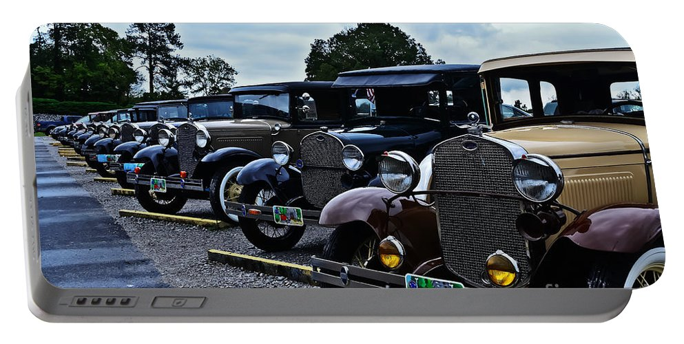 Travel Portable Battery Charger featuring the photograph A Lot Of Classic Cars by Elvis Vaughn