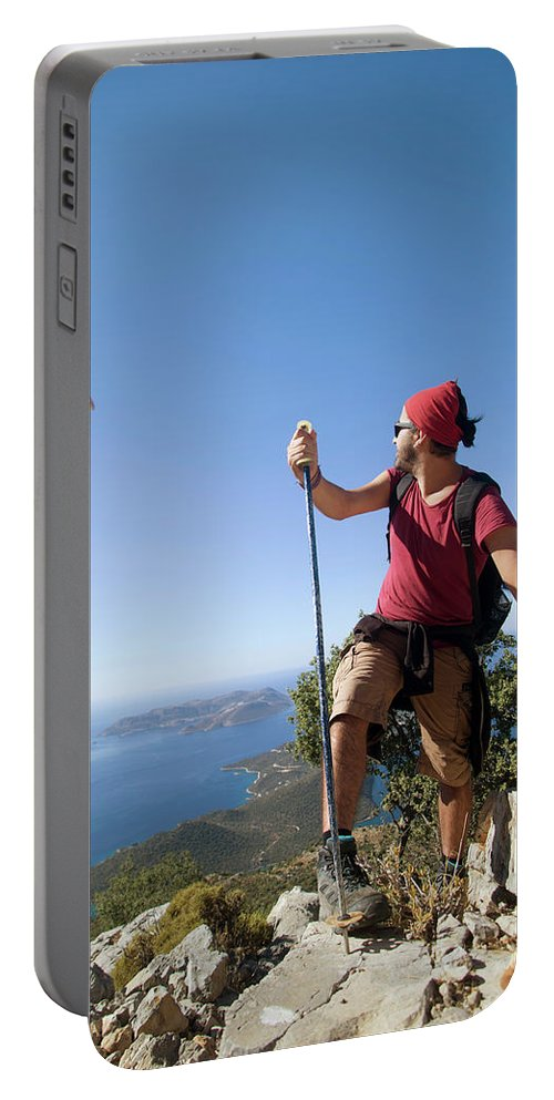 Antalya Portable Battery Charger featuring the photograph A Male Climber Looking At Paragliding by Me Studio