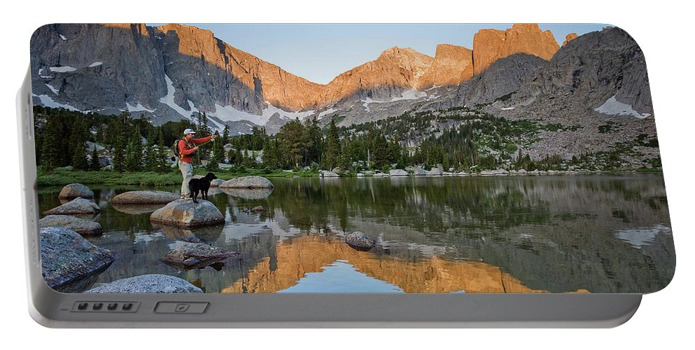 Adult Portable Battery Charger featuring the photograph A Male Fly Fisherman In A Lake by Mark Fisher