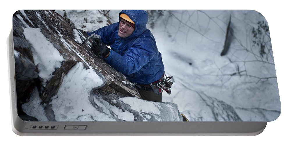 30-34 Years Portable Battery Charger featuring the photograph A Man Ascends A Dramatic, Challenging by Christopher Beauchamp