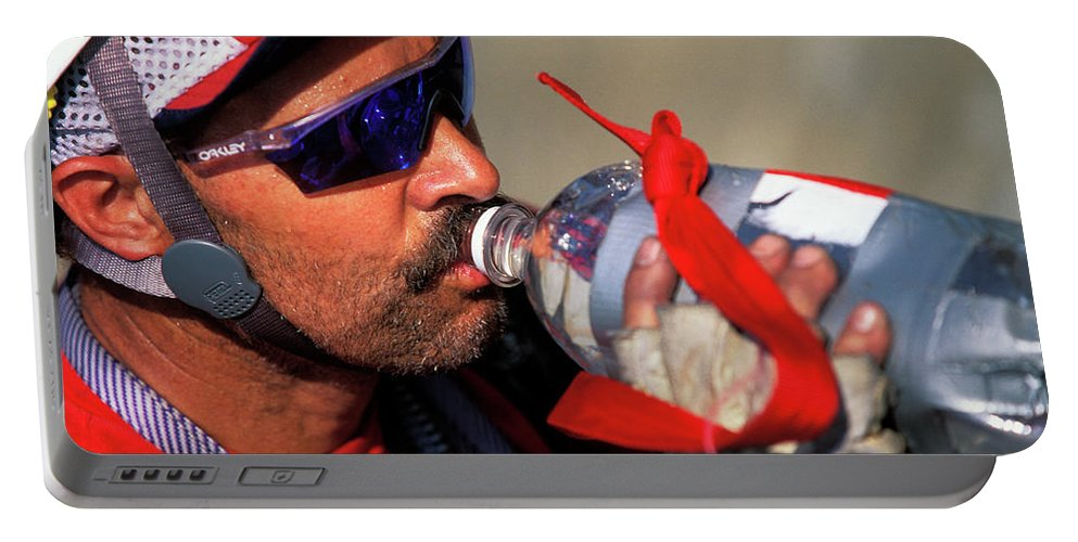 Action Portable Battery Charger featuring the photograph A Man Drinking Water by Corey Rich
