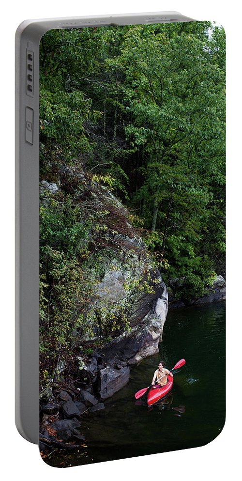 30-34 Years Portable Battery Charger featuring the photograph A Man Floats Along In A Kayak by Michael Hanson