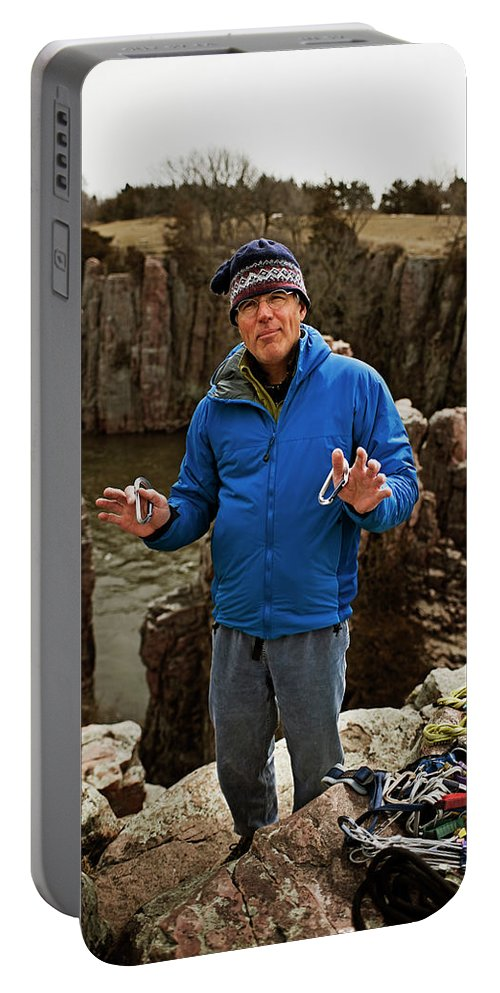 50s Portable Battery Charger featuring the photograph A Man Holds Climbing Gear And Smiles by Aaron Packard