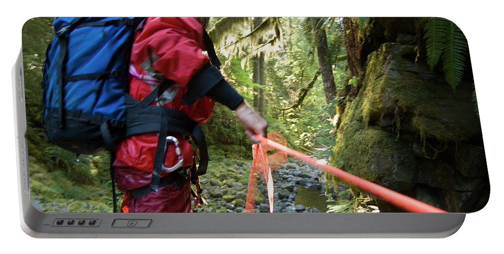 Abseil Portable Battery Charger featuring the photograph A Man Lowers A Rope For Canyoning by Frank Huster