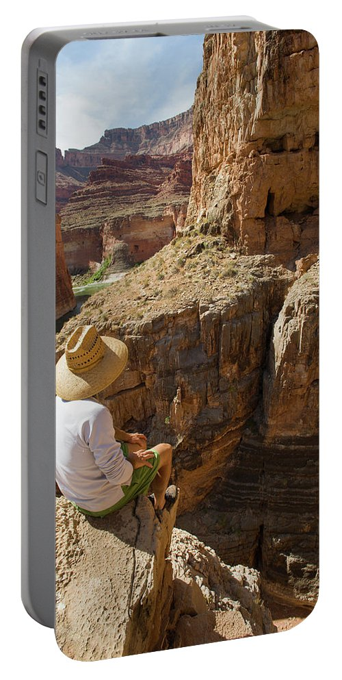 Adult Portable Battery Charger featuring the photograph A Man Sits High On The Rim Of South by Doug Marshall