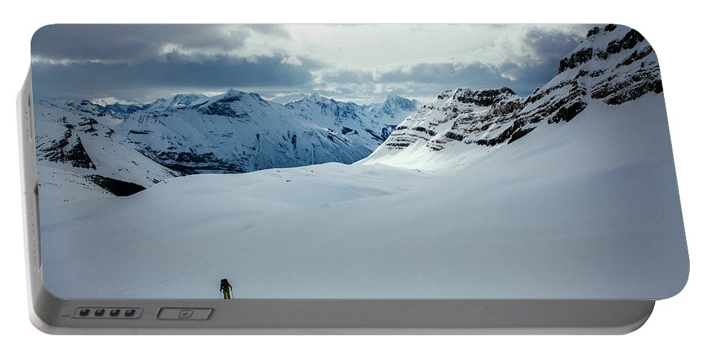 Cold Temperature Portable Battery Charger featuring the photograph A Man Ski Touring Near Icefall Lodge by Mike Schirf