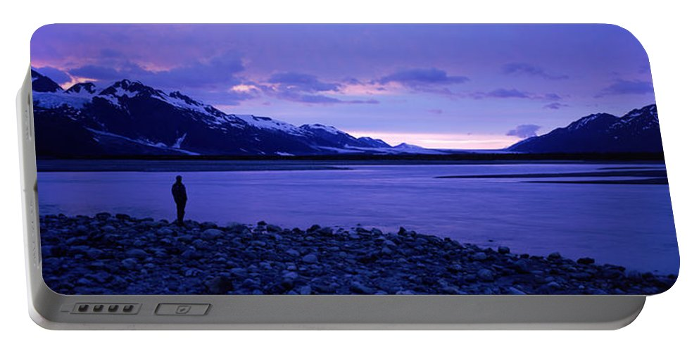 Alsek Portable Battery Charger featuring the photograph A Man Standing On The Edge Of A Lake by David McLain