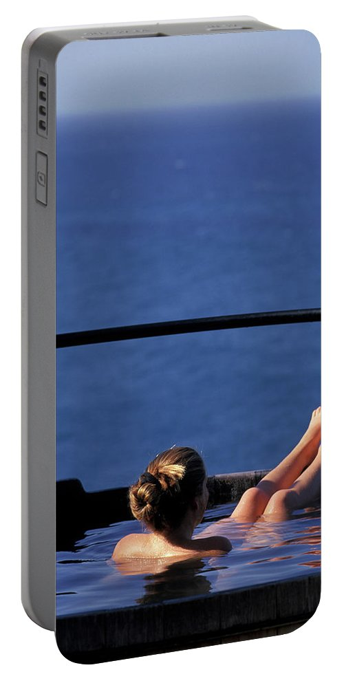 Bathing Portable Battery Charger featuring the photograph A Nude Woman In A Hot Spring by Corey Rich